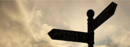 signpost against the sky